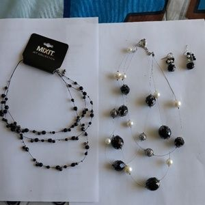 Jewelry - 2 necklaces with matching earrings.